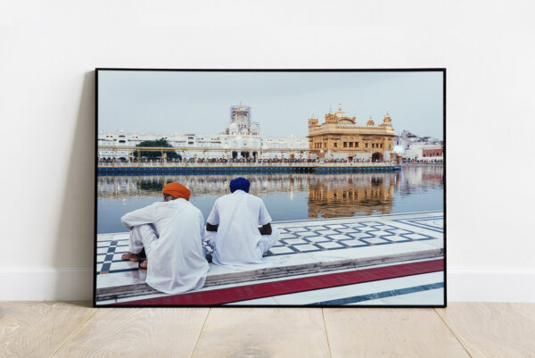 Print of a scene of the Golden Temple at sunset with two Sikhs in the foreground, in Amritsar