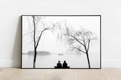 Black and white print of a couple contemplating the views of Kunming Lake, near The Summer Palace, in Beijing