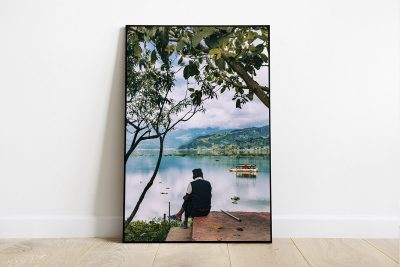 Print of a man contemplating the views of Phewa Lake, in Pokhara