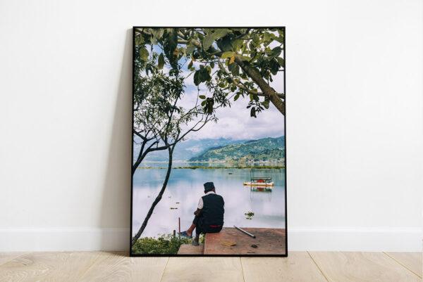 Print of a man contemplating the views of Phewa Lake, in Pokhara