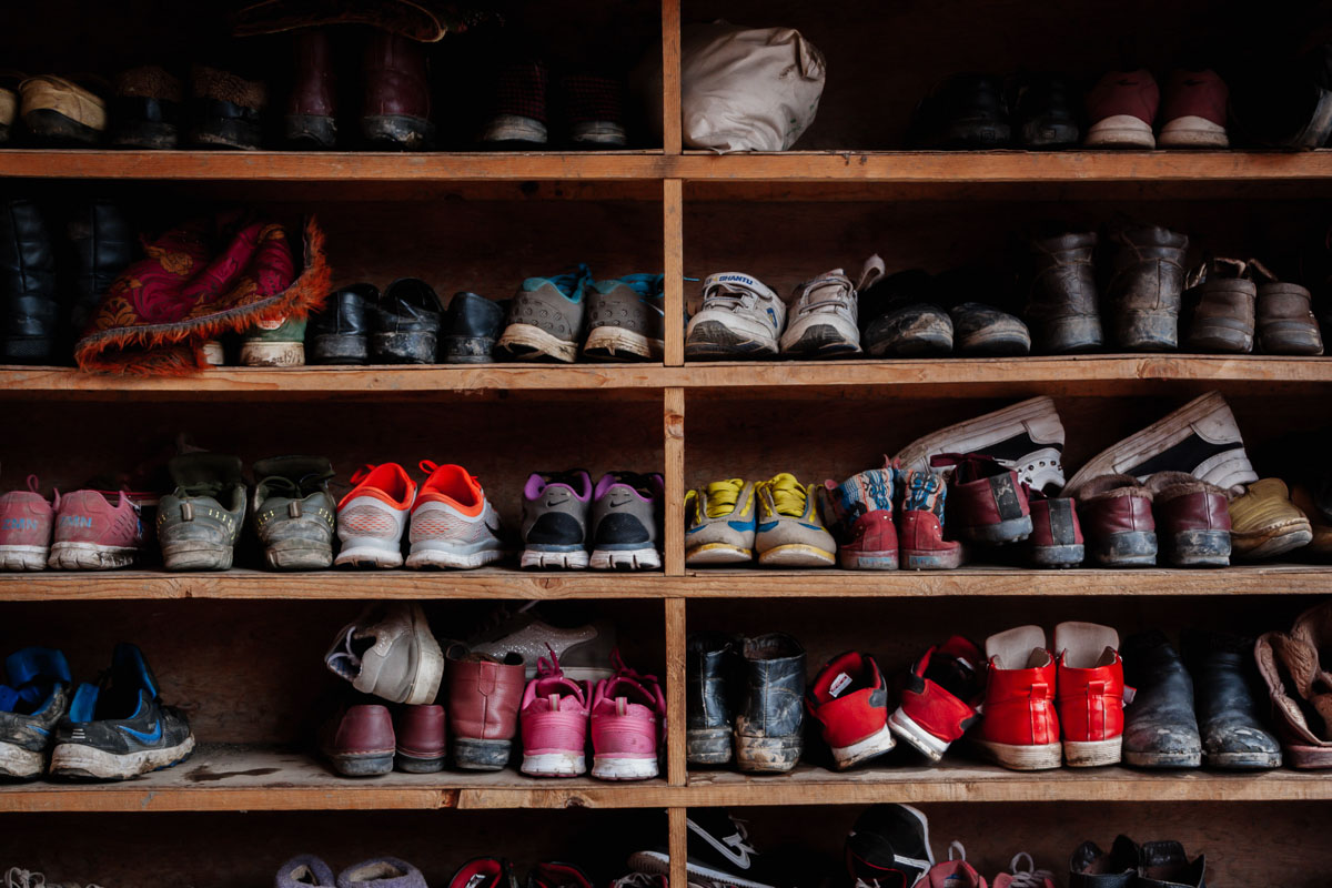 Detail of shoes in the entrance of the main temple of Larung Gar, China
