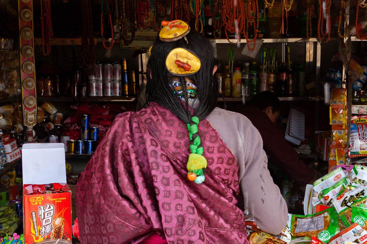 Traditional Tibetan hair style, in Larung Gar, China