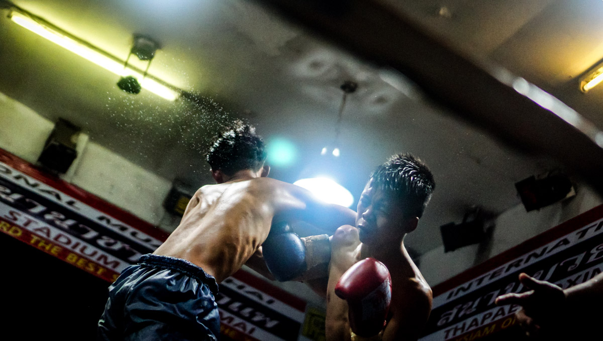 Punch crossing between two male fighters, in Chiang Mai, Thailand