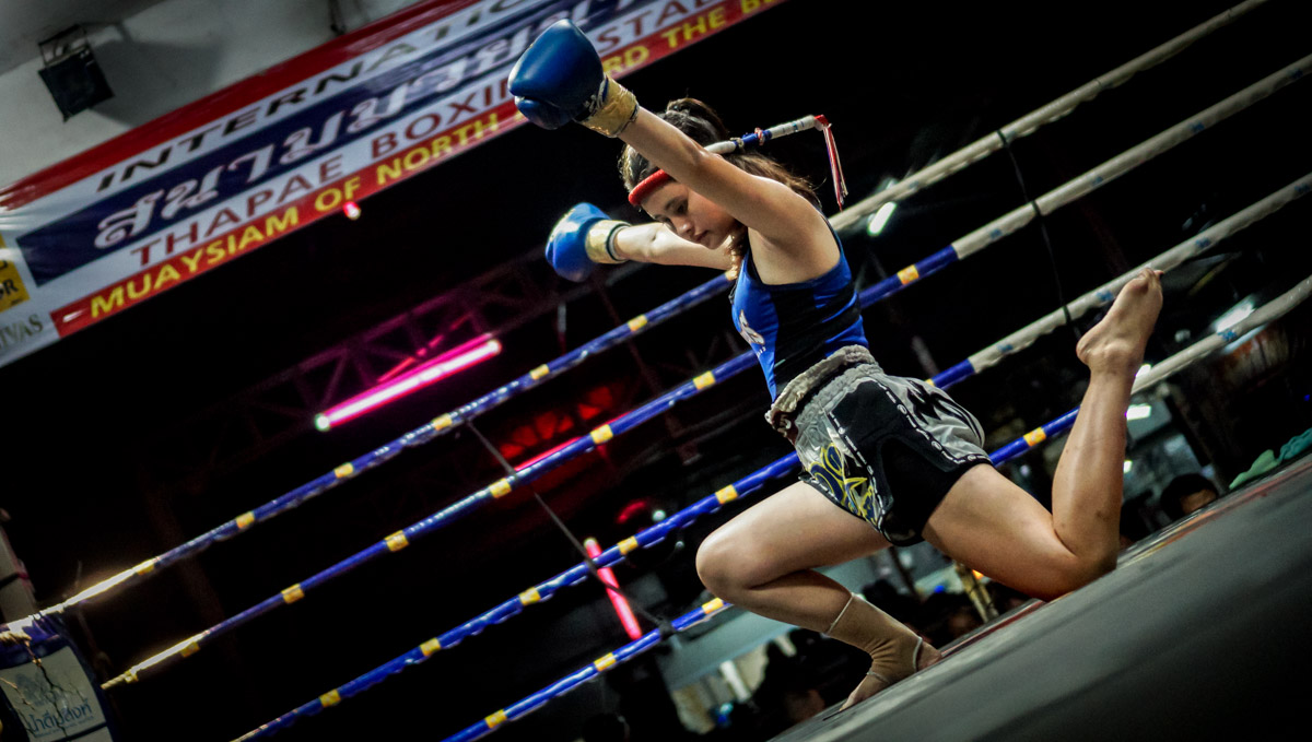 Female fighter performing the Way Kru, in Chiang Mai, Thailand