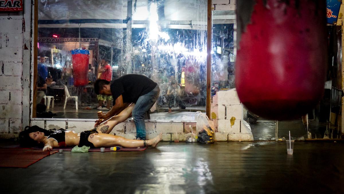 Luisa Botta being massaged by her trainer, in Chiang Mai, Thailand