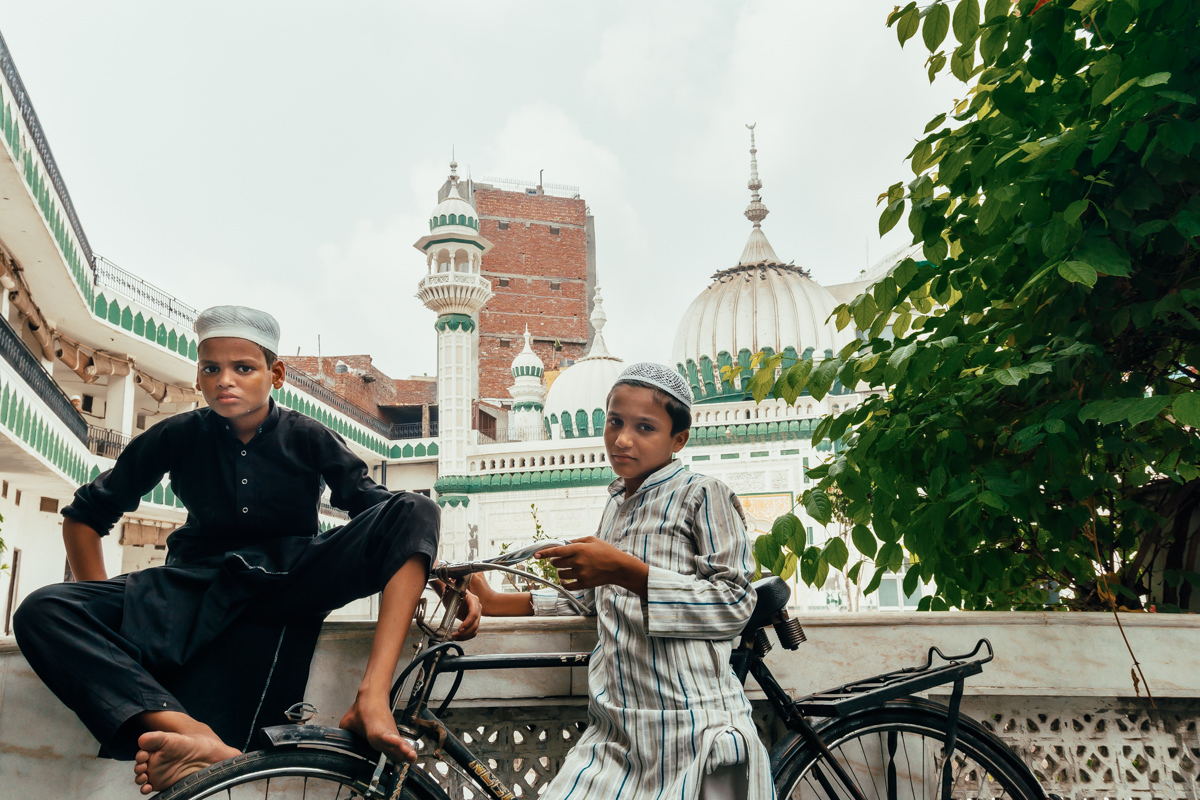 Portrait of 2 muslim boys in front of Khairuddin Mosque, in Amritsar, India