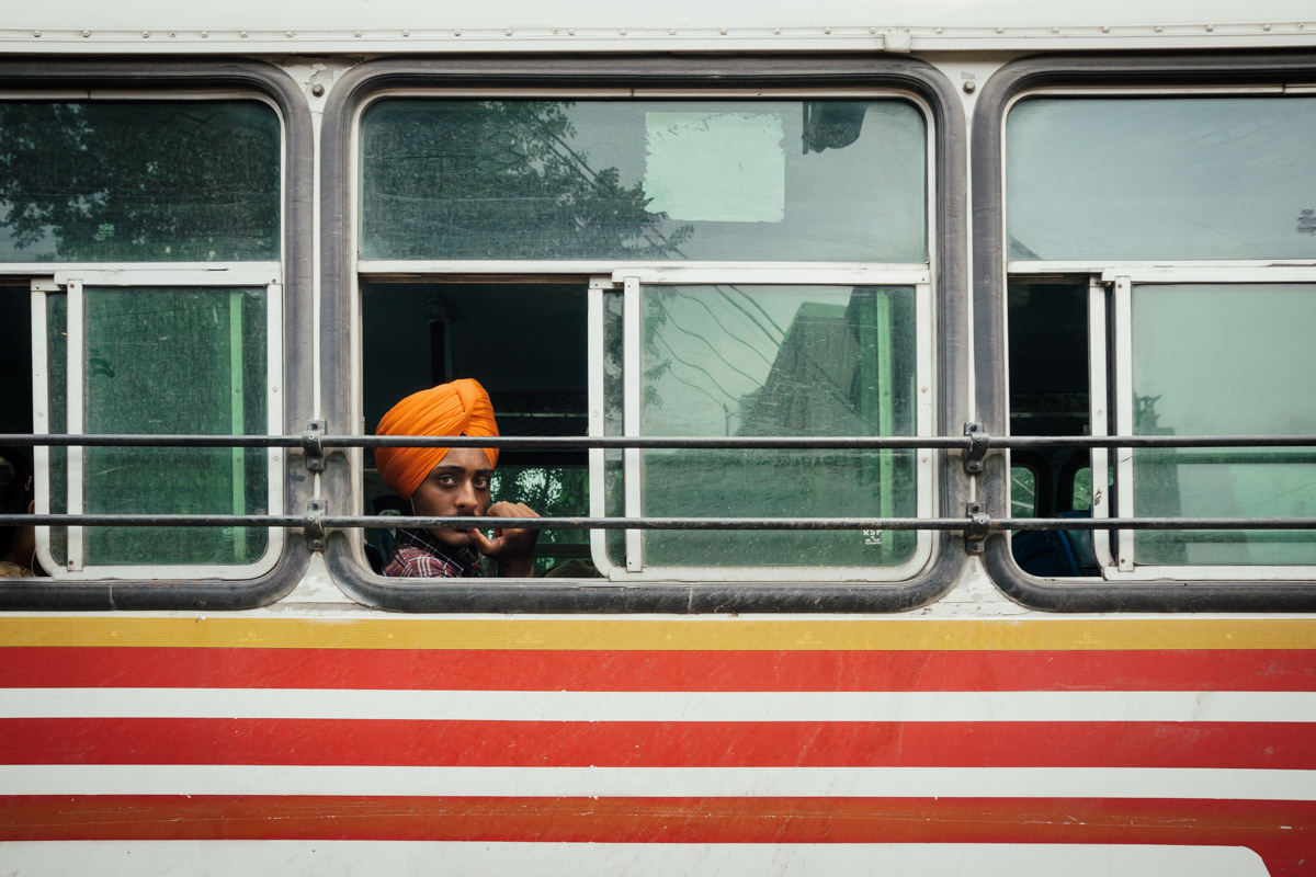 Sikh in a bus, surrounded by lines, in Amritsar, India