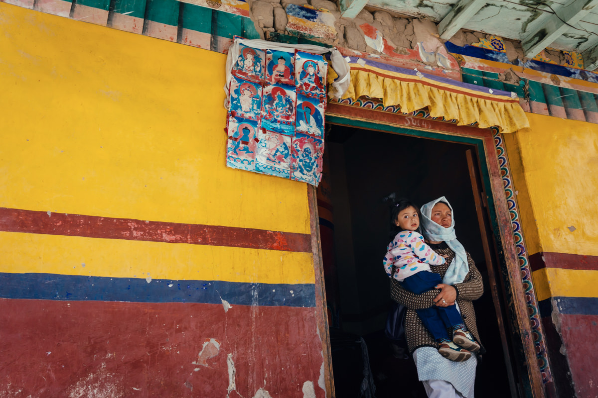 Woman and daughter after praying in Leh, India