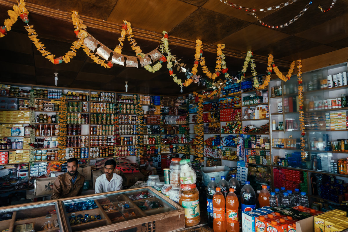 Men in a grocery shop of Dixit, India