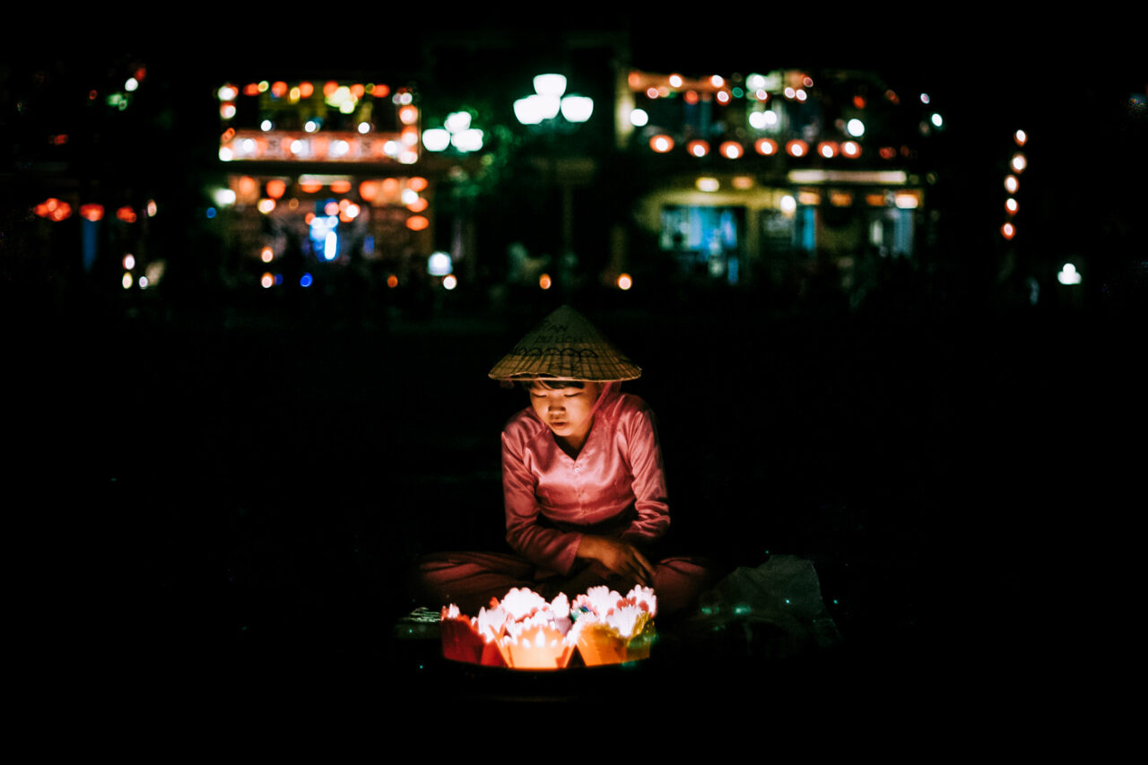 Girl selling candle lamps in Hoi An, VietnamFerry wheel in Agra, India