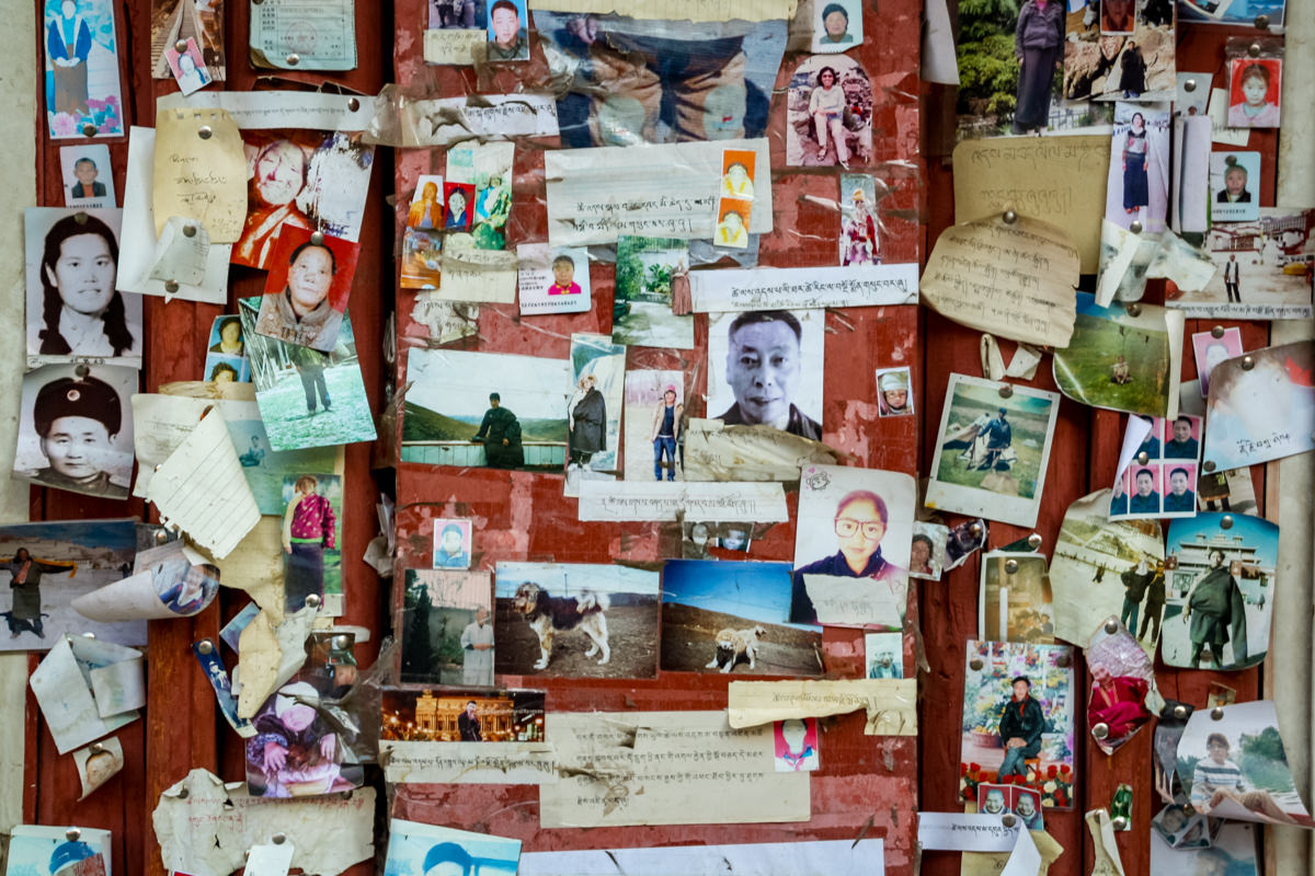 Notice board with photos of the deceases in Larung Gar, China