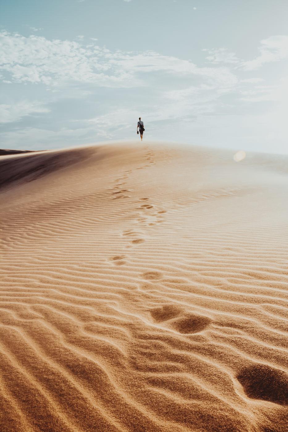 Footprints in The White Dunes of the desert of Mui Ne, Vietnam