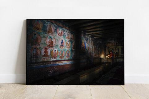 Print of a Tibetan monk in the dark in Leh, India