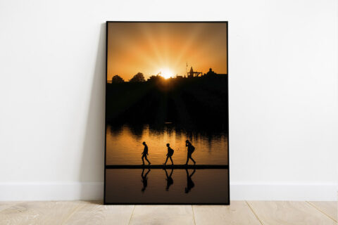 Print of a sunset with silhouettes in Pushkar, India