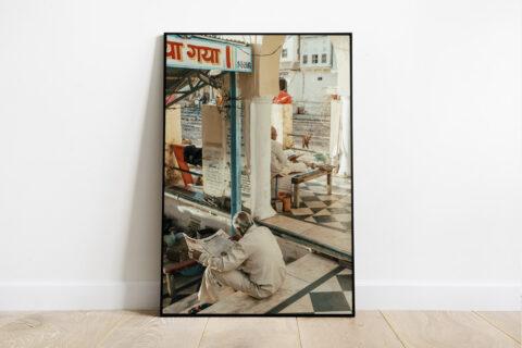 Print of two men reading in Pushkar in India